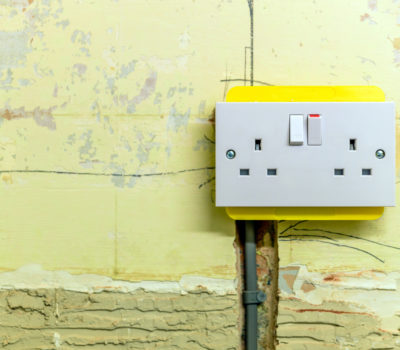electric socket in a wall during renovation in england uk
